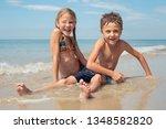 two happy little children... | Shutterstock . vector #1348582820
