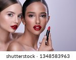 two girls with naked shoulders... | Shutterstock . vector #1348583963