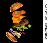 tasty hamburger with flying... | Shutterstock . vector #1348657499