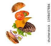 tasty hamburger with flying... | Shutterstock . vector #1348657886