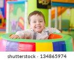 happy little boy playing in... | Shutterstock . vector #134865974