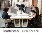business team working at desks... | Shutterstock . vector #1348773470