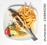 Small photo of Fish grill with onion, garlic, capper,olives. Baked fish with rosemary, onion, olives, capper and lemon served with chips. Maltese food. Maltese cuisine. Mediterranean cuisine