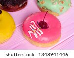 donuts with icing on wooden... | Shutterstock . vector #1348941446