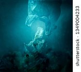 Small photo of Plastic bag floating underwater and dispersing waste, ocean pollution and environmental damage concept