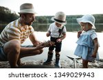 a mature father with small... | Shutterstock . vector #1349029943