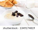 oatmeal breakfast with... | Shutterstock . vector #1349174819