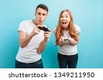 excited young couple  a guy and ... | Shutterstock . vector #1349211950