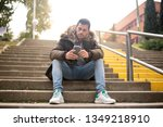 young man sitting in the street ... | Shutterstock . vector #1349218910