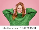 young redhead girl holding... | Shutterstock . vector #1349221583