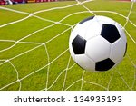 soccer ball in the goal after... | Shutterstock . vector #134935193