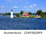 cottage with lighthouse on one... | Shutterstock . vector #1349382899