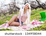 young woman relaxing on grass... | Shutterstock . vector #134958044