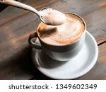 cappuchino on the wooden table... | Shutterstock . vector #1349602349