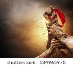 hands tighten medal in a dark... | Shutterstock . vector #134965970