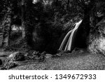 waterfall in the woods in pale  ... | Shutterstock . vector #1349672933