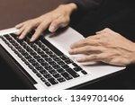 man hands typing on a laptop   Shutterstock . vector #1349701406
