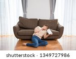 the woman who sits down on a... | Shutterstock . vector #1349727986