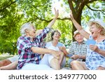 vital seniors playing card... | Shutterstock . vector #1349777000