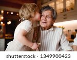 senior grandmother with small... | Shutterstock . vector #1349900423