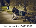 Homeless Man Sitting On A Benc...