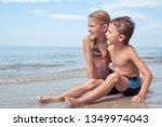 two happy little children... | Shutterstock . vector #1349974043