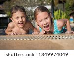 two happy little children... | Shutterstock . vector #1349974049