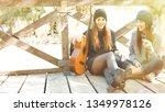 two girl friends sitting... | Shutterstock . vector #1349978126