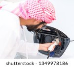 arab young man recharging... | Shutterstock . vector #1349978186