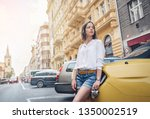 young attractive woman with a... | Shutterstock . vector #1350002519