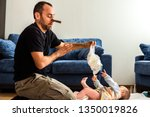 dad with a pincer on his nose... | Shutterstock . vector #1350019826