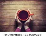 Stock photo woman holding hot cup of tea 135009398