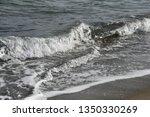 splashing waves with white foam ... | Shutterstock . vector #1350330269