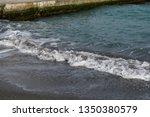 splashing tide with white foam... | Shutterstock . vector #1350380579