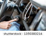 woman starting car engine with... | Shutterstock . vector #1350383216