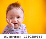 nice baby boy chewing his own... | Shutterstock . vector #1350389963