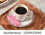 a cup of black coffee with... | Shutterstock . vector #1350413960