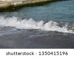 white tide and blue sea water... | Shutterstock . vector #1350415196