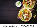 tortilla wrap with falafel and... | Shutterstock . vector #1350432539