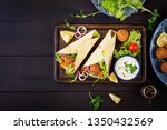 tortilla wrap with falafel and... | Shutterstock . vector #1350432569