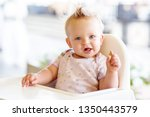 cute baby eating biscuit on the ... | Shutterstock . vector #1350443579