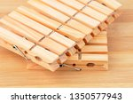 wooden clothes pegs on natural... | Shutterstock . vector #1350577943
