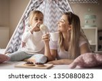 this is so tasty. mother and... | Shutterstock . vector #1350880823