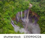 tumpak sewu waterfall located... | Shutterstock . vector #1350904226