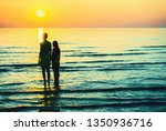 romantic couple silhouette at... | Shutterstock . vector #1350936716