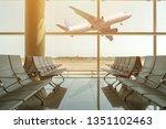 empty chairs in the departure... | Shutterstock . vector #1351102463