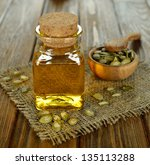 pumpkin seed oil in a glass... | Shutterstock . vector #135113288