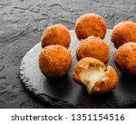 fried potato cheese balls or... | Shutterstock . vector #1351154516
