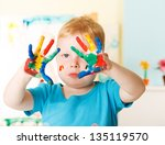 little boy with hands painted... | Shutterstock . vector #135119570