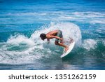 riding the waves. costa rica ... | Shutterstock . vector #1351262159